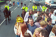 Ravers protesting on London street. The first Criminal Justice March, Park Lane, London, UK, 1st of May 1994.
