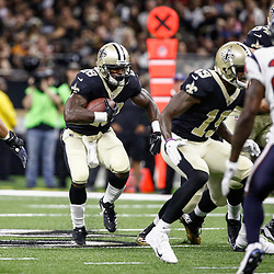 Aug 26, 2017; New Orleans, LA, USA; New Orleans Saints running back Adrian Peterson (28) runs against the Houston Texans during the first quarter of a preseason game at the Mercedes-Benz Superdome. Mandatory Credit: Derick E. Hingle-USA TODAY Sports