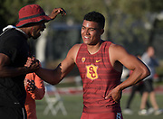Ayden Owens of Southern California (right) is congratulated by assistant coach Carjay Lyles after running 47.66 for the top time in the decathlon 400m during the Bryan Clay Invitational in Azusa, Calif., Wednesday, April 17, 2019.
