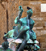 Detail from the Fountain of Neptune in the Piazza della Signoria (a square in front of the Palazzo Vecchio) Florence, Italy. It was commissioned in 1565 and is by the sculptor Bartolomeo Ammannati, the design however was done by Baccio Bandinelli before he died. The sculpture is made from Apuan Marble, and is meant to represent the Florentine dominion over the sea. It was commissioned for a wedding, and the face of Neptune resembles that of Cosimo I de'Medici, Duke of Florence/Grand Duke of Tuscany, and father of the groom.