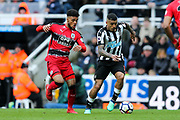 Kenedy (#15) of Newcastle United takes on Elias Kachunga (#9) of Huddersfield Town during the Premier League match between Newcastle United and Huddersfield Town at St. James's Park, Newcastle, England on 31 March 2018. Picture by Craig Doyle.