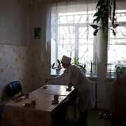 DONETSK, UKRAINE - OCTOBER 15, 2014: A nurse prepares tea and biscuits for blood donors at a blood bank in Donetsk, as military leaders of the self-proclaimed Donetsk People's Republic visited the clinic to also donate blood. CREDIT: Paulo Nunes dos Santos