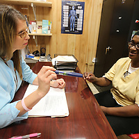 Tara Kilgore, Population Health Manager for Franklin Furniture in Houston, talks with Catherine Townsend, a Franklin Furniture employee, about her insulin pen at the plant. Franklin has teamed up with the North Mississippi Medical Center in adding an onsite population health nurse to help employees to manage chronic conditions as well as checking up on those who are recovering from surgery or hospital stays.