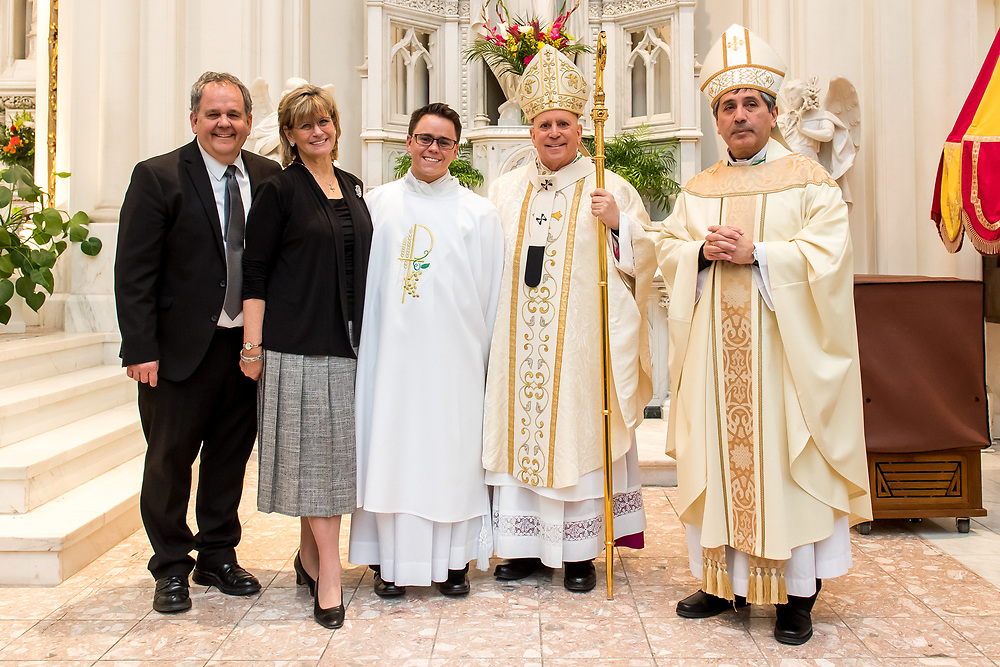 DENVER, CO - MARCH 2: Denver Archbishop Samuel Aquila and Denver auxiliary bishop Jorge Rodriguez pose for a photograph with Deacon Christian James Mast and his family following the transitional deacon ordination at the Cathedral Basilica of the Immaculate Conception on March 2, 2019, in Denver, Colorado. (Photo by Daniel Petty/for Denver Catholic)