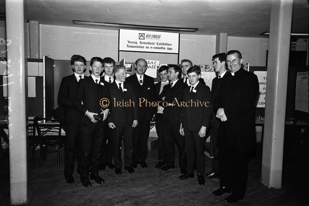 05/01/1965.01/05/1965.5th March 1965.The Aer Lingus Young Scientist Exhibition at the.Manson House..Jack Lynch, Minister for Industry and Commerce. Also in the photo is Rev. C. Mc Carthy Principal of St. Finbarrs, Sean O'Riordain Science teacher and three prize winners Edward Mc Carthy (2nd prize senior chemistry), Michael O'Regan (2nd prize junior physics) and Brendan Buckley (3rd prize junior chemistry) also students of St. Finbarrs College Cork   .