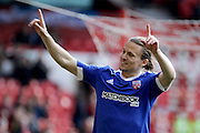 Brentford midfielder Alan McCormack celebrates towards the Brentford fans during the Sky Bet Championship match between Nottingham Forest and Brentford at the City Ground, Nottingham, England on 2 April 2016. Photo by Chris Wynne.