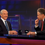 "Host Jon Stewart and Republican Presidential candidate Ron Paul appear on set during Comedy Central's ""The Daily Show with Jon Stewart"" in New York City."