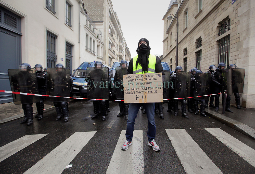 19 January 2019. Paris, France.<br /> Gilets Jaunes - Acte X take to the streets of Paris. A lone protester makes his feelings known to a wall of CRS riot police who have sealed a road along the route. An estimated 7,000 people took part in the looping 14 km route from Place des Invalides to protest tax hikes from the Government of Emmanuel Macron imposed on the people. An estimated 80,000 people took part in protests across the country. Regrettably the movement has attracted a violent element of agitators who often face off with riot police at the end of the marches which tends to deflect attention away from the message of the vast majority of peaceful protesters.<br /> Photo©; Charlie Varley/varleypix.com