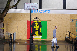 © Licensed to London News Pictures. 25/08/2012. London, UK A branch of Barclays Bank is boarded. . Shops and premises are boarded up today 25th August 2012 ahead of the Notting Hill Carnival which takes place this weekend.  Photo credit : Stephen Simpson/LNP