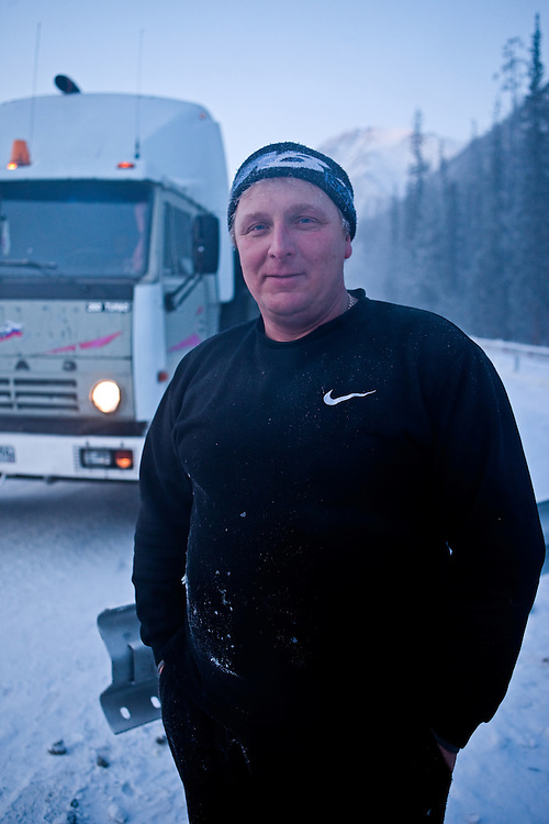"Truck driver who is riding from Yakutsk to Magadan on the ""The Road of Bones"" (M56 Kolyma Highway) during a break at Razluka brook. ""The Road of Bones"" was constructed in the Stalin era of the USSR by Dalstroy construction directorate. The first stretch was built by the inmates of the Sevvostlag labor camp in 1932. The construction continued (by inmates of gulag camps) until 1953. The road is treated as a memorial, because the bones of the people who died while constructing it were laid beneath or around the road. The Verkhoyansk Range is a mountain range of eastern Siberia, spanning ca. 1000 km (600 m.), across the Sakha Republic..The world's lowest temperatures for inhabited places have been recorded in this region, and there is quite deep snow cover for most of the year. Verkhoyansk Range, Jakutien, Yakutia, Russian Federation, Russia, RUS, 18.01.2010"