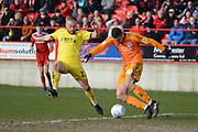 Accrington Stanley goalkeeper Dimitar Evtimov (30) clears the ball under pressure from Fleetwood Town forward Paddy Madden (17) during the EFL Sky Bet League 1 match between Accrington Stanley and Fleetwood Town at the Fraser Eagle Stadium, Accrington, England on 30 March 2019.
