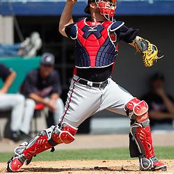 March 4, 2011; Viera, FL, USA; Atlanta Braves catcher Brian McCann (16) during a spring training exhibition game against the Washington Nationals at Space Coast Stadium.  Mandatory Credit: Derick E. Hingle