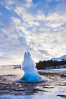 The geysir Strokkur spouting in winter. South Iceland.