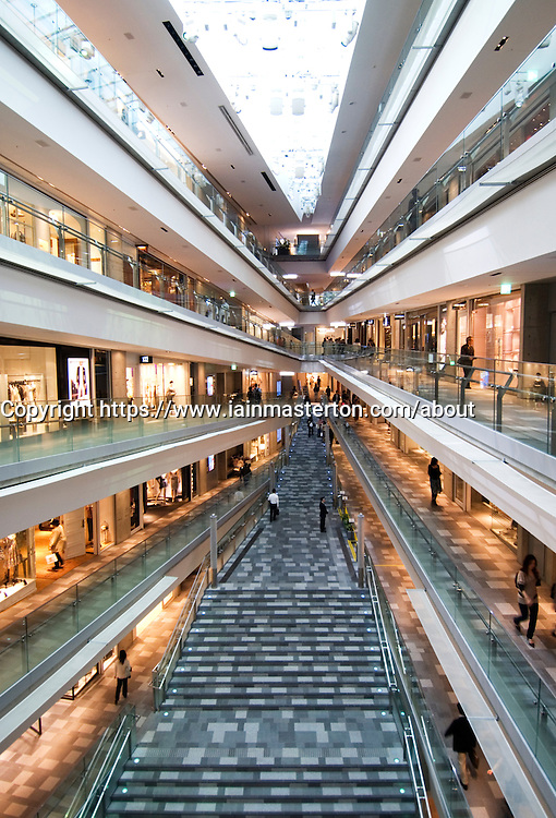 Interior of upmarket Omotesando Hills shopping mall in Tokyo Japan architect Tadao Ando