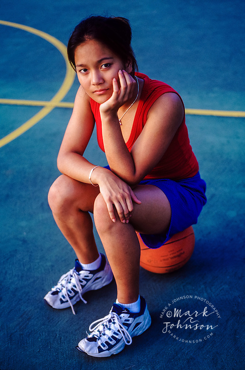 Teen girl on a basketball court ****Model Release available