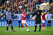 Referee Tony Harrington speaks to Sheffield Wednesday vice captain Barry Bannan before the penalty is taken during the EFL Sky Bet Championship match between Sheffield Wednesday and Bristol City at Hillsborough, Sheffield, England on 22 December 2019.