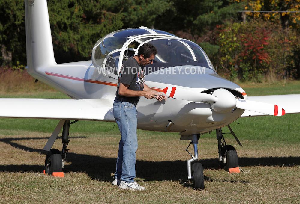 Wurtsboro, New York - A pilot works on his Valentin 17E Taifun motorglider at Wurtsboro Airport on Oct. 9, 2010.