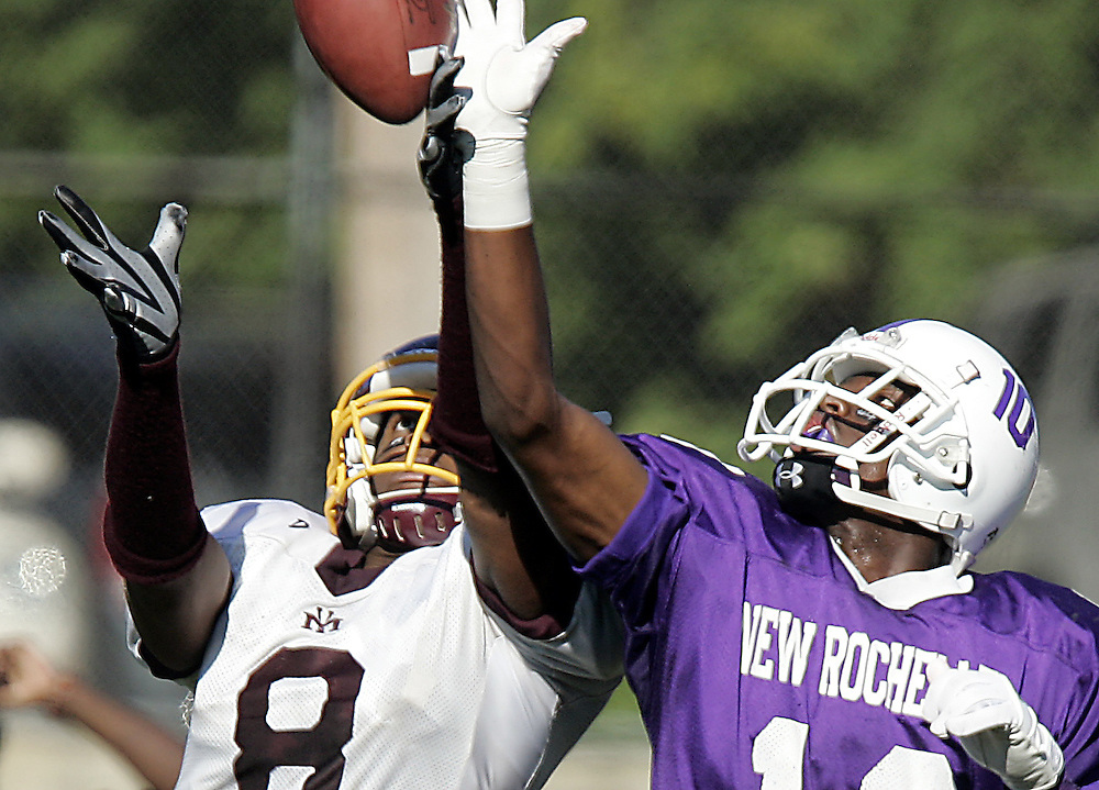 New Rochelle defensive back Rakeem Callands, right, knocks this pass away from Mount Vernon receiver Andre Gaynor during a varsity football game between New Rochelle and Mount Vernon at New Rochelle High School Oct. 11, 2008.  New Rochelle won the game 14-6.  ( Mike Roy / The Journal News )