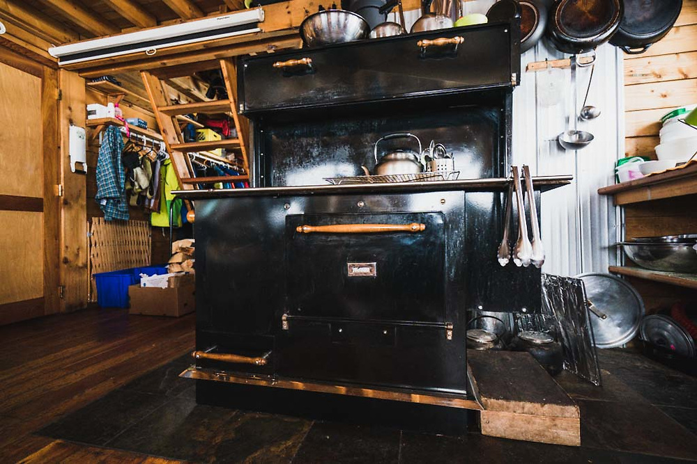 The center piece of the Burnie Glacier Chalet is this well-loved Pioneer Made Wood Cookstove.