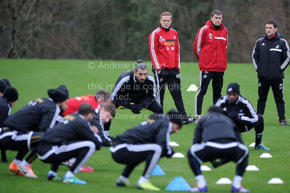 Swansea city manager Garry Monk keeps an eye on Swansea city FC team training  in Swansea, South Wales on Thursday 6th Feb 2014. the team are training ahead of their Barclays Premier league match, South Wales Derby match against Cardiff city.<br /> pic by Andrew Orchard, Andrew Orchard sports photography.