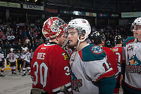 KELOWNA, CANADA - APRIL 25: Carter Rigby #11 of the Kelowna Rockets shakes hands with Corbin Boes #30 of the Portland Winterhawks on April 25, 2014 during Game 5 of the third round of WHL Playoffs at Prospera Place in Kelowna, British Columbia, Canada. The Portland Winterhawks won 7 - 3 and took the Western Conference Championship for the fourth year in a row earning them a place in the WHL final.  (Photo by Marissa Baecker/Getty Images)  *** Local Caption *** Carter Rigby; Corbin Boes;