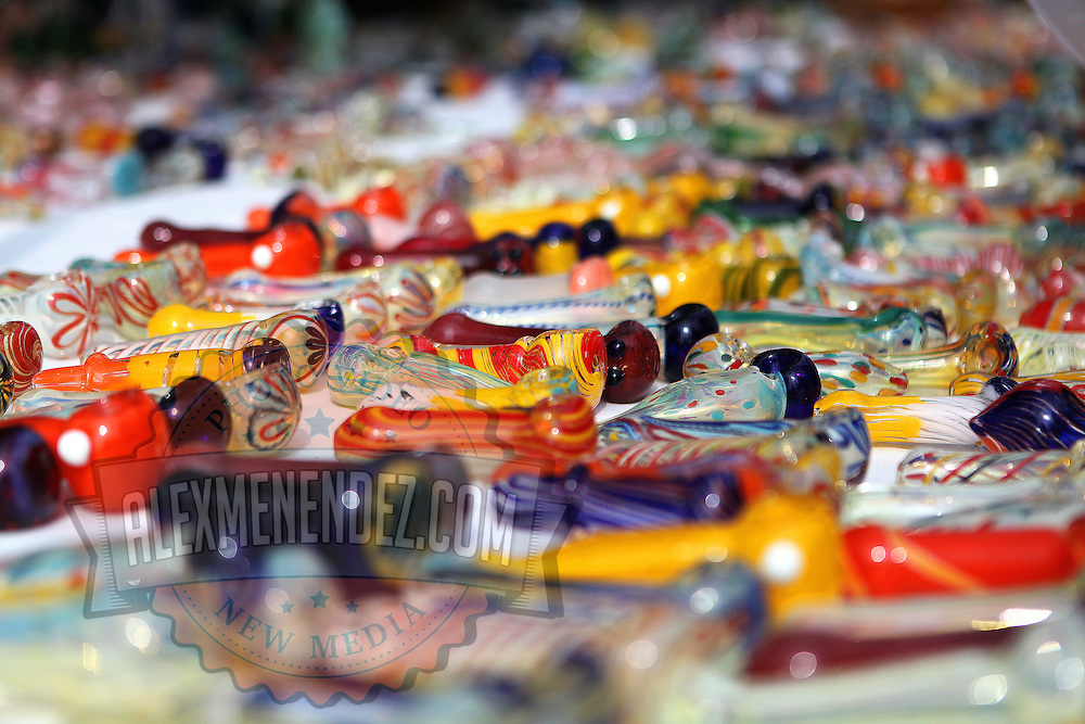 Glass pipes for smoking marijuana are shown for sale during the Earthday Birthday Concert at the Citrus Bowl in Central Florida.  State residents, with the help of a group called United for Care, are urging backers to sign petitions to get the legalization of medicinal marijuana on the ballot for the early 2014 Florida legislative session. This image taken in Central Florida on Saturday, April 13, 2013. (Photo/Alex Menendez)