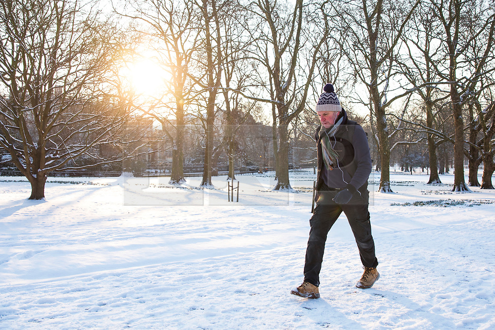 © Licensed to London News Pictures. 28/02/2018. London, UK. A man walks through Green Park in London after heavy overnight snowfall as the 'Beast from the East brings freezing Siberian air to the UK. Photo credit: Rob Pinney/LNP