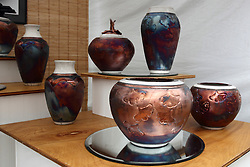 11 July 2015:  Distinctive pottery displayed by Christine D Davis is displayed at the 2015 Sugar Creek Arts Festival in Uptown Normal Illinois