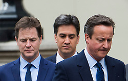 © London News Pictures. 08/05/2015. NICK CLEGG, DAVID CAMERON and ED MILIBAND attend a VE day ceremony on Whitehall, London on the day David Cameron formed a majority government. Photo credit: Ben Cawthra/LNP