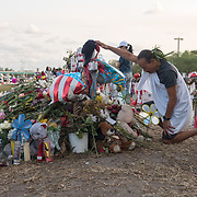 TUESDAY, FEBRUARY 27- 2018---PARKLAND, FLORIDA--<br /> Mourners pray and look on the site of a memorial at Marjory Stoneman Douglas High School  for the victims of February 14 school massacre.<br /> (Photo by Angel Valentin/FREELANCE)