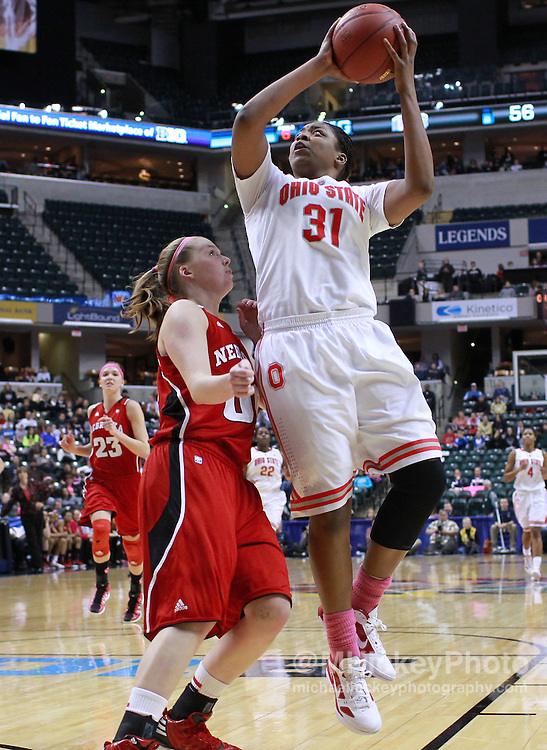 March 03, 2012; Indianapolis, IN, USA; Ohio State Buckeyes guard Raven Ferguson (31) shoots the ball over Nebraska Cornhuskers guard Lindsey Moore (00) during the semifinals of the 2012 Big Ten Tournament at Bankers Life Fieldhouse. Nebraska defeated Ohio State 77-62. Mandatory credit: Michael Hickey-US PRESSWIRE