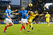 Anton Walkes (2) of Portsmouth battles for possession with Andy Barcham (17) of AFC Wimbledon during the EFL Sky Bet League 1 match between Portsmouth and AFC Wimbledon at Fratton Park, Portsmouth, England on 1 January 2019.