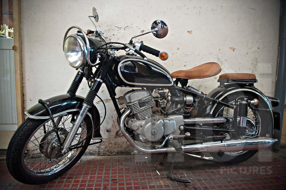 Vintage motorbike parked along a street in Ho Chi Minh City, Vietnam, Southeast Asia