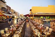Lampedusa, Italia - 1 luglio 2011. Decine di tavolini vuoti lungo via Roma, la strada principale di Lampedusa. Dop l'emergenza immigrazione dello scorso inverno, la maggior parte degli esercizio commerciali ha subito perdite ingenti a causa di un calo del 70% del turismo sullisola..Ph. Roberto Salomone Ag. Controluce
