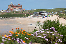 "© Licensed to London News Pictures. 11/05/2020. Newquay, UK. Fistral beach on the North coast of Cornwall seen nearly empty, the day after British Prime Minister Boris Johnson announced a 'road map' to lift lockdown restrictions due to Covid-19, (Coronavirus). A rise in ""staycations"" - the concept of holidaying in your home country rather than travelling abroad - is expected, with many visitors planning to visit Cornwall. However, an ongoing campaign titled ""#ComeBackLater"" is trying to persuade tourists not to visit the county until it is safe to do so. Photo credit : Tom Nicholson/LNP"