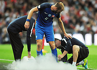 Football - 2017 / 2018 FIFA World Cup Qualifier - UEFA Group F: England vs. Slovakia<br /> <br /> Adam Nemec of Slovakia has a spray put on his injured ankle with  at Wembley Stadium.<br /> <br /> COLORSPORT/ANDREW COWIE