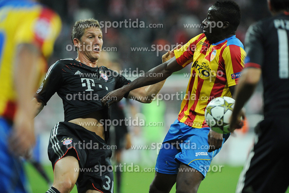 19.09.2012, Allianz Arena, Muenchen, GER, UEFA Champions League, FC Bayern Muenchen vs FC Valencia, Gruppe F, im Bild Bastian SCHWEINSTEIGER (FC Bayern Muenchen) gegen Aly CISSOKHO (FC Valencia) // during the UEFA Champions League group F match between FC Bayern Munich and Valencia CF at the Allianz Arena, Munich, Germany on 2012/09/19. EXPA Pictures © 2012, PhotoCredit: EXPA/ Eibner/ Wolfgang Stuetzle..***** ATTENTION - OUT OF GER *****
