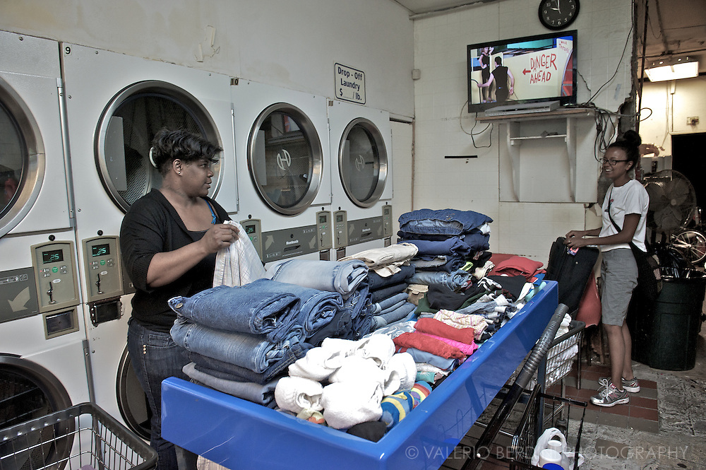 Two women chat in a laundry in Harlem.