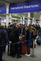 © Licensed to London News Pictures. 23/12/2016. London, UK. Passengers line up at St Pancras Eurostar terminal. The Christmas getaway begins  today with<br />