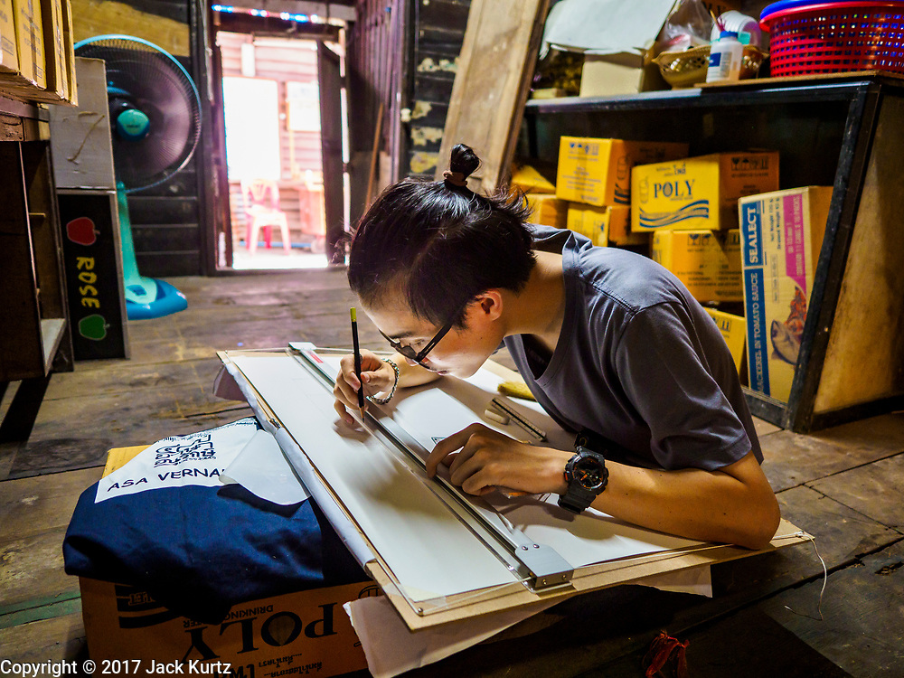 16 MAY 2017 - BANGKOK, THAILAND: An architectural student sketches the interior of an abandoned home in Pom Mahakan. Bangkok city officials are expected to tear the structure down in coming weeks. The final evictions of the remaining families in Pom Mahakan, a slum community in a 19th century fort in Bangkok, have started. City officials are moving the residents out of the fort. NGOs and historic preservation organizations protested the city's action but city officials did not relent and started evicting the remaining families in early March.           PHOTO BY JACK KURTZ