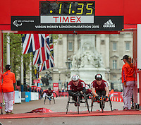 Mini London marathon 2015, The Borough Challenge Wheelchair boys under 17 Nathan Maguire #28 crosses the line ahead of Isaac Towers #21 in a time of 11:35. The Virgin Money Giving Mini Marathon, Sunday 26th April 2015.<br />