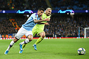 Manchester City defender Joao Cancelo (27) and Dinamo Zagreb defender Marin Leovac (22) race for the ball  during the Champions League match between Manchester City and Dinamo Zagreb at the Etihad Stadium, Manchester, England on 1 October 2019.