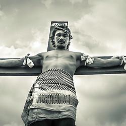 Rolly Bautista Pantoja being crucified on Good Friday, San Fernando, Pampanga, Philippines