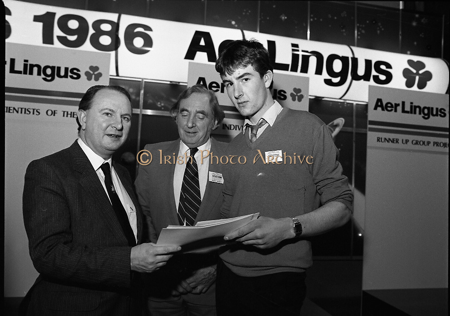 "Aer Lingus Young Scientist Exhibition..1986..10.01.1986..01.10.1986..10th January 1986..The annual Aer Lingus,sponsored,Young Scientists Exhibition was held at the RDS,Ballsbridge,Dublin.The Overall winners of the competition were Ms Breda Maguire and Ms Niamh Mulvany..They are students at The Rosary College,Raheny,Dublin. The Tanaiste, Mr Dick Spring TD was on hand to present the awards...Photograph shows Brian Gribbon accepting his award for Physical, Mathematical and Applied Sciences (Intermediate Pupils) from Mr Con Power, Director Economic Policy,Conferation Of Irish Industry. Brian, from Magherlane Road,Randalstown, Co Antrim,won with his entry ""Computer Controlled Pig Feed Unit"". He is a student at St Olcans School,Randalstown. Also included in the photograph is Mr Niall G Weldon, Chairman of the Judging Panel."