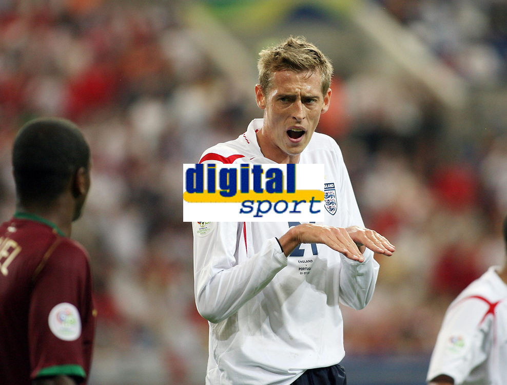 Photo: Chris Ratcliffe.<br /> England v Portugal. Quarter Finals, FIFA World Cup 2006. 01/07/2006.<br /> Peter Crouch of England suggests Portugal dive.