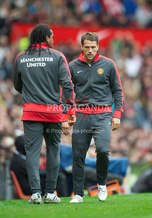 MANCHESTER, ENGLAND - Sunday, September 19, 2010: Manchester United's former Liverpool player Michael Owen warms-up during the Premiership match at Old Trafford. (Photo by David Rawcliffe/Propaganda)