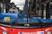 A driver with the bus company Stagecoach reads during a well-earned rest from busy London traffic.