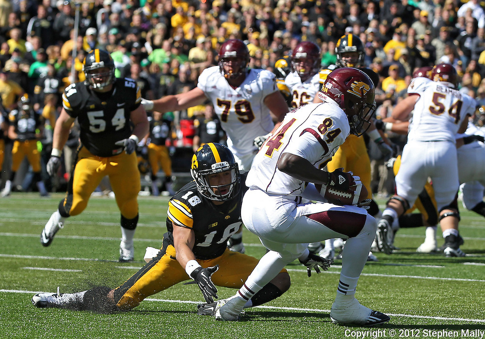 September 22 2012: Central Michigan Chippewas wide receiver Titus Davis (84) spins away from Iowa Hawkeyes cornerback Micah Hyde (18) on a 13 yard touchdown reception during the second half of the NCAA football game between the Central Michigan Chippewas and the Iowa Hawkeyes at Kinnick Stadium in Iowa City, Iowa on Saturday September 22, 2012. Central Michigan defeated Iowa 32-31.