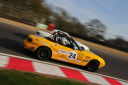 Derek Brook takes the inside line to pass Iain Cameron at Druids Hairpin at Brands Hatch