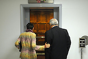 United States Congresswoman Rosa DeLauro, 69, a Democrat representing Connecticut's Third district. She is currently in her eleventh term, having been in Congress for twenty one years...DeLauro talks to another Congressman in the elevators of the Rayburn Building, where her office is, on the day the Democrats unanimously agreed not to support the Republican Party's congressional plan to raise the debt ceiling.